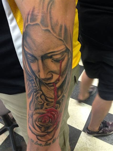 virgin mary with roses tattoo amazing religious bleeding eye on