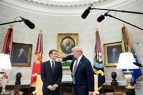 president trump oval office trump wipes dandruff off visiting french president macron