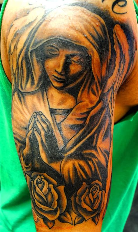 angel roses tattoo 25 impressive praying designs and ideas