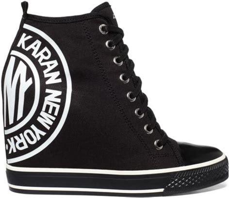 dkny wedge sneakers on sale dkny grommet wedge sneakers in black lyst