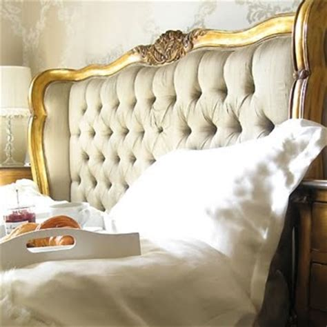gold tufted headboard tufted ivory gold headboard it s in the details