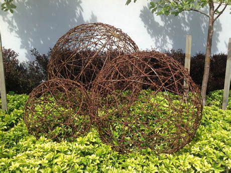 australian rusted barbed wire ball garden art