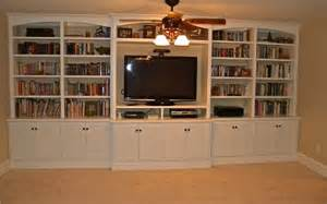 built in entertainment center bookshelves eclectic family room philadelphia by artisan