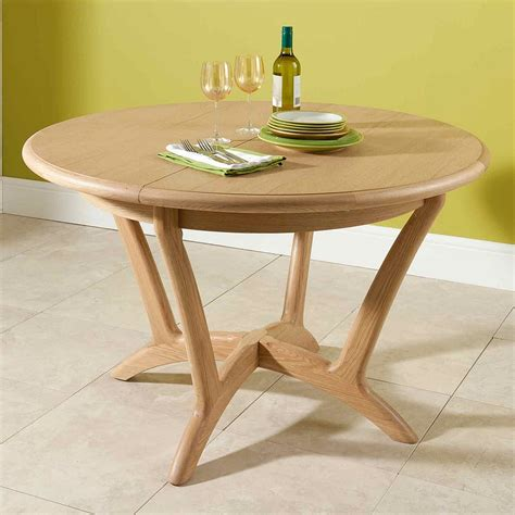 Extending Circular Dining Table Extending Circular Dining Table Nathan Shades In Oak