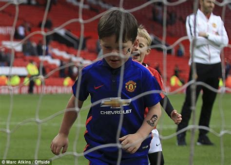 messi tattoo fake manchester united s wayne rooney takes sons kai and klay