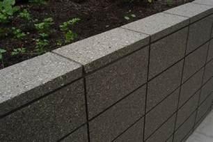 honed grey coloured masonry retaining wall sealed in a wet