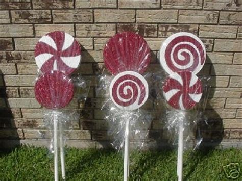 christmas yard lollipops lawn made using styrofoam circles from michael s covered in cellophane tie with ribbon
