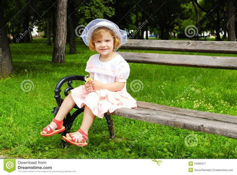 girl bench little girl sitting on the bench royalty free stock