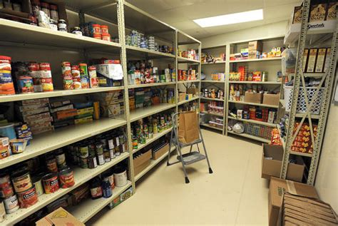Pantry Worker by Arundel Schools Open Their Own Food Pantries