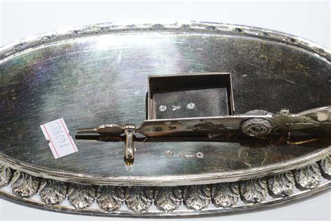 smorza candela due smorzacandela diversi in argento quella ovale