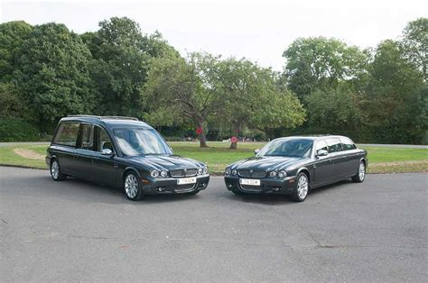 black jaguar hearse and limousine green s carriage masters