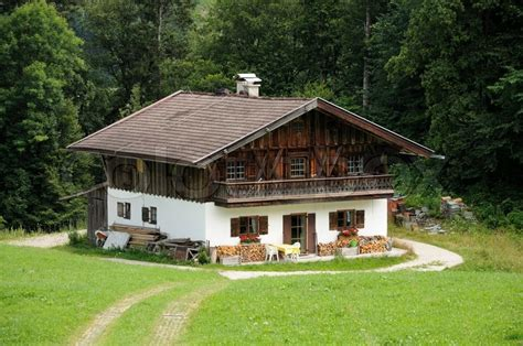 wooden house in the german alps stock photo colourbox