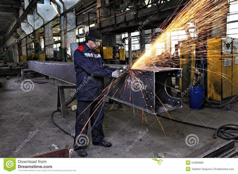 Kaos Welder Metal Workers metal worker grinds weld steel sections using an angle grinder editorial stock photo image