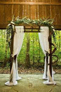 diy wedding arbor decor different flower arrangement maybe our covered bridge wedding