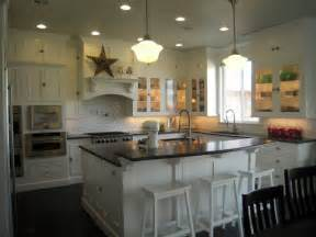 Island with raised breakfast bar white sawhorse stools kitchen island