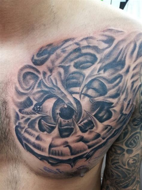 biomechanical chest tattoo tattoos by adrian flores at