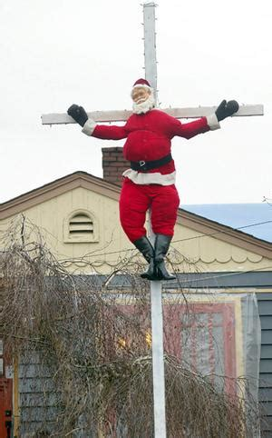 santa nailed  cross  protest  xmas