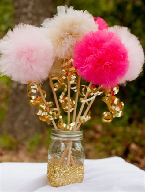 pink and gold pom pom wands princess centerpiece