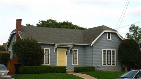 slate blue house slate blue clapboard house with white trim and yellow door by ww whist via flickr