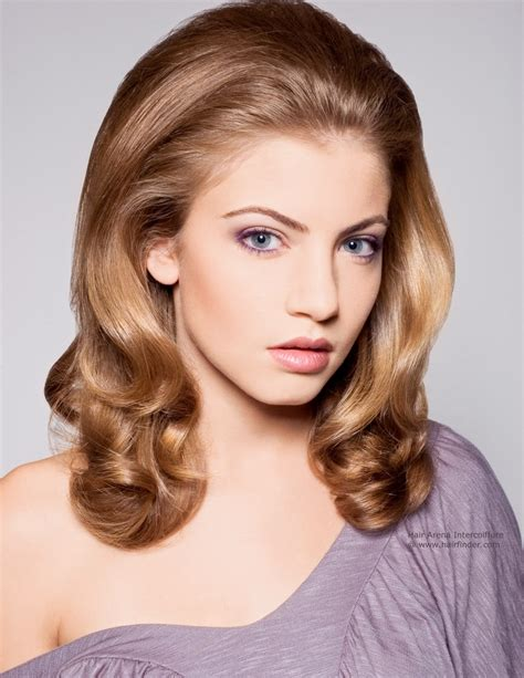 hair colour and styles for 60s 1960s inspired hairstyle with long flowing waves that curl