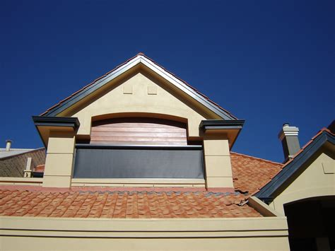 qld residence welcomes the summer under new issey awnings