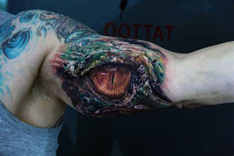 awesome dragon eye tattoo by sergio gas