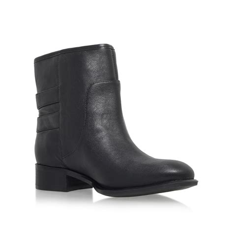 nine west justthis flat buckle detail ankle boots in black