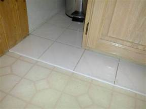 how can i level a transition in a floor before gluing a