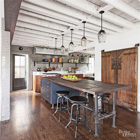 industrial style kitchen island industrial meets rustic in this kitchen beams