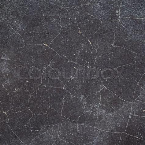 Cracked black concrete wall /floor texture background