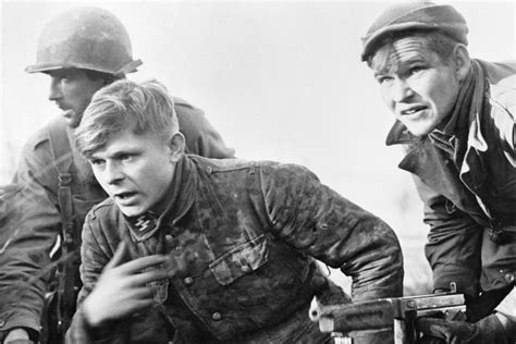 two men of the 82nd airborne division bringing in a young