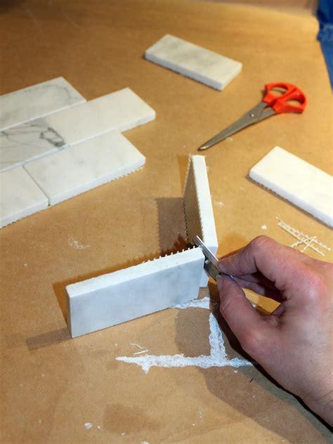 cutting tile backsplash how to install a marble tile backsplash hgtv