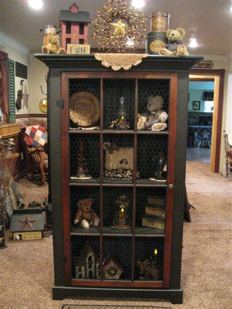 armoire decorating ideas best 25 primitive cabinets ideas on pinterest corner