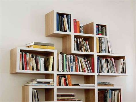 unique design of criss cross bookshelf with white wall