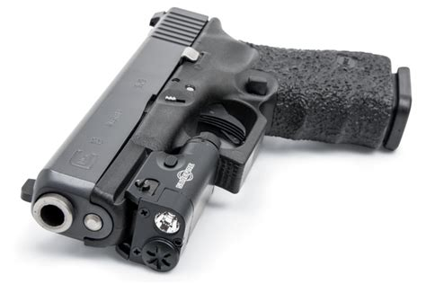 low profile pistol light gun tech surefire s professional grade light systems