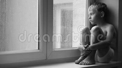 Windowsill Definition Lonely Boy Looks At Raindrops Through The Window