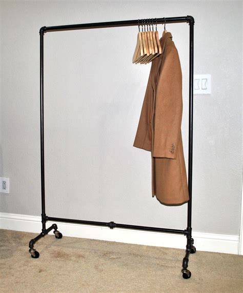 Plumbing Pipe Clothes Rack by Industrial Iron Plumbing Pipe Rolling Garment Rack