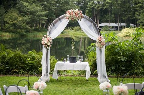 wedding arch draping juliet garden roses in a white light peachy pink arch