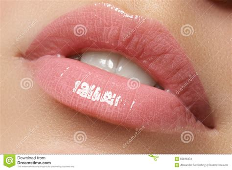 Brighten Up Your Smile With Sexysmile Lip Gloss by And White Teeth Isolated In White