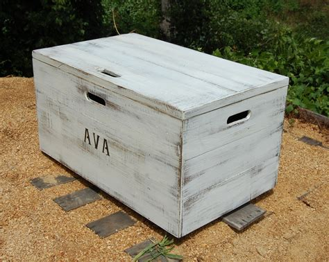large white wooden storage boxes