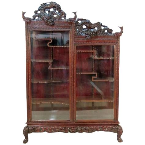 Antique Curio Cabinets by Antique Figural Carved Curio Cabinet At 1stdibs