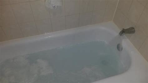 bathtub filled with water from shower this was