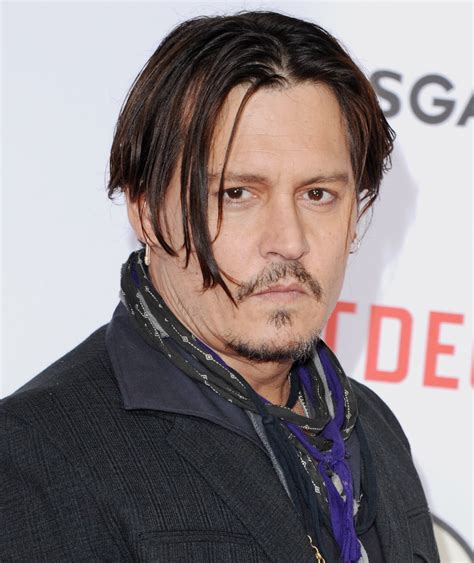 best johnny depp depp says he mined his inner evil to play gangster