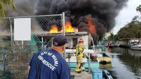 boat yard miami miami fl firefighters battle boatyard storage fire