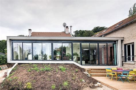 Connecting Three Historic Dwellings with a Modern