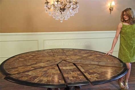 large  walnut dining room table  leaves seats