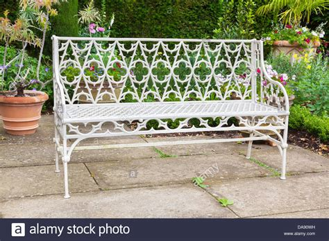 old garden bench old garden bench situated in a landscaped garden stock photo royalty free image