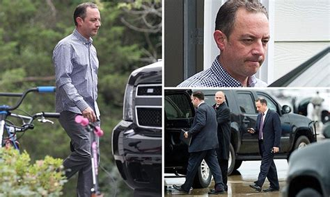 Reince Priebus pictured looking glum outside family home