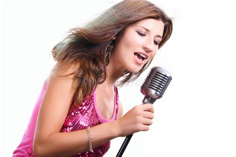 beautiful girl with a microphone singing a song stock image image 10462997