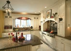 Country White Kitchen Cabinets Country Kitchen With Antique White Painted Cabinetry Wainscoting On The Island And Plate